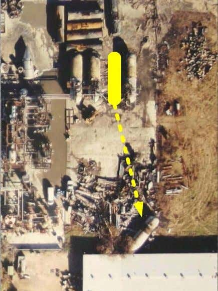 vessel was propelled 150 feet where it impacted a warehouse Figure 1. Explosion displaced Tank 7