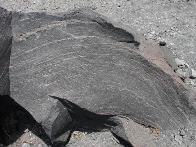 from partial melting of pre-exiting rock in the Earth's mantle or crust . An example of