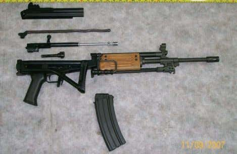 B y 1959 the AK-47 was modified and adopted as the AKM Figures 5 and 6: