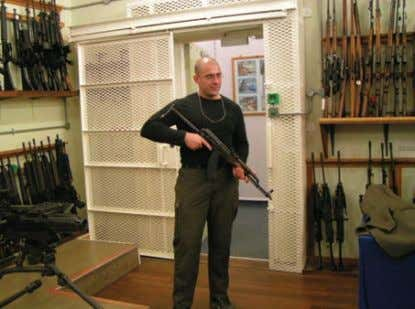 his book 'The AK-47 and AK-74 Kalashnikov Rifles and Their Figure 9: Author with AKMS, featuring