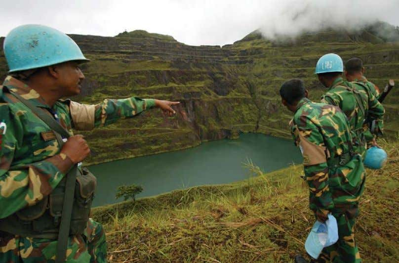 by armed groups that could take the country back to war. UN security forces overlooking the