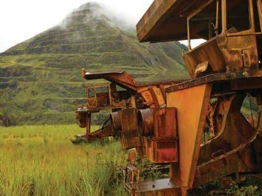 working on different aspects of the company's project. Nimba mine: rusting equipment of the Liberian American