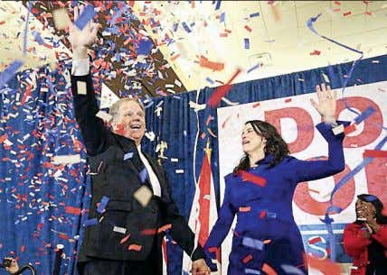upset as a Democrat wins in a deeply conservative state Doug Jones with wife Louise wave