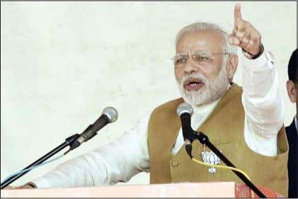 Prime Minister Narendra Modi addresses a party rally in Kalol, Gandhinagar.