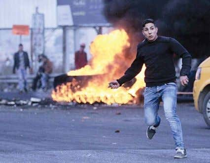 an independent Palestinian state on the territories A Palestinian protester hurls a stone during clashes over