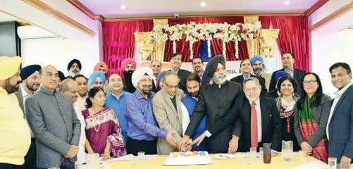 Singh Malhotra as a member. INOC, USA also celebrated Sonia Members at the cake cutting event
