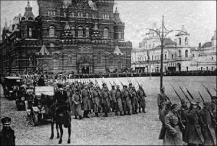 was brutally shot and their bodies dumped down a mineshaft. Bolshevik forces marching on Red Square