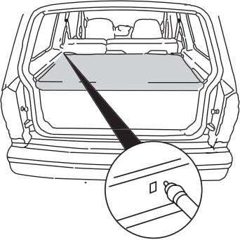 the rear seat on the rear trim panels. To operate the shade: 1. Grasp the pull