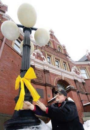teachers, researchers, students, and journalists. Figure 2-27 ▲ A yellow ribbon is tied outside a municipal