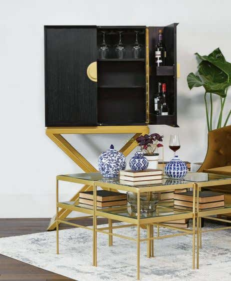 Robby bar cabinet gets a boost on open steel frame with elongated aluminium pulls, warmed