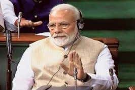 "eco­ nomy through this power­ house,"" he observed. Thumbs up: Prime Minister Narendra Modi applauding Nirmala"