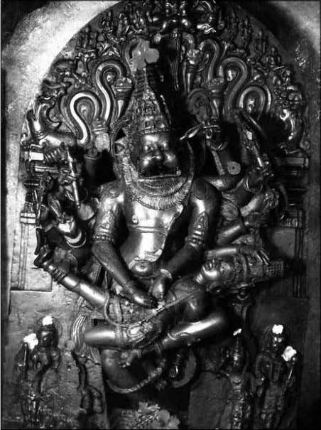 raised and bent in order to place the demon Hiranyakashipu The deity of Jwala Nrsimha 