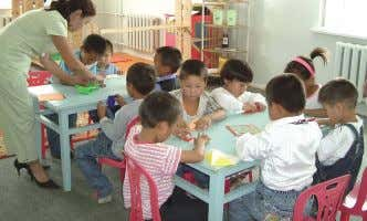 education for the increased number of local poor children. Children at the child development center Working