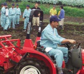 the practical know-how of Japanese agricultural high schools Agricultural practice using a tractor (©JBIC) In
