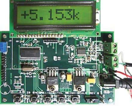 are used to calculate the weight and display them. Figure 1. Digital Weigh-Scale Reference Design Board