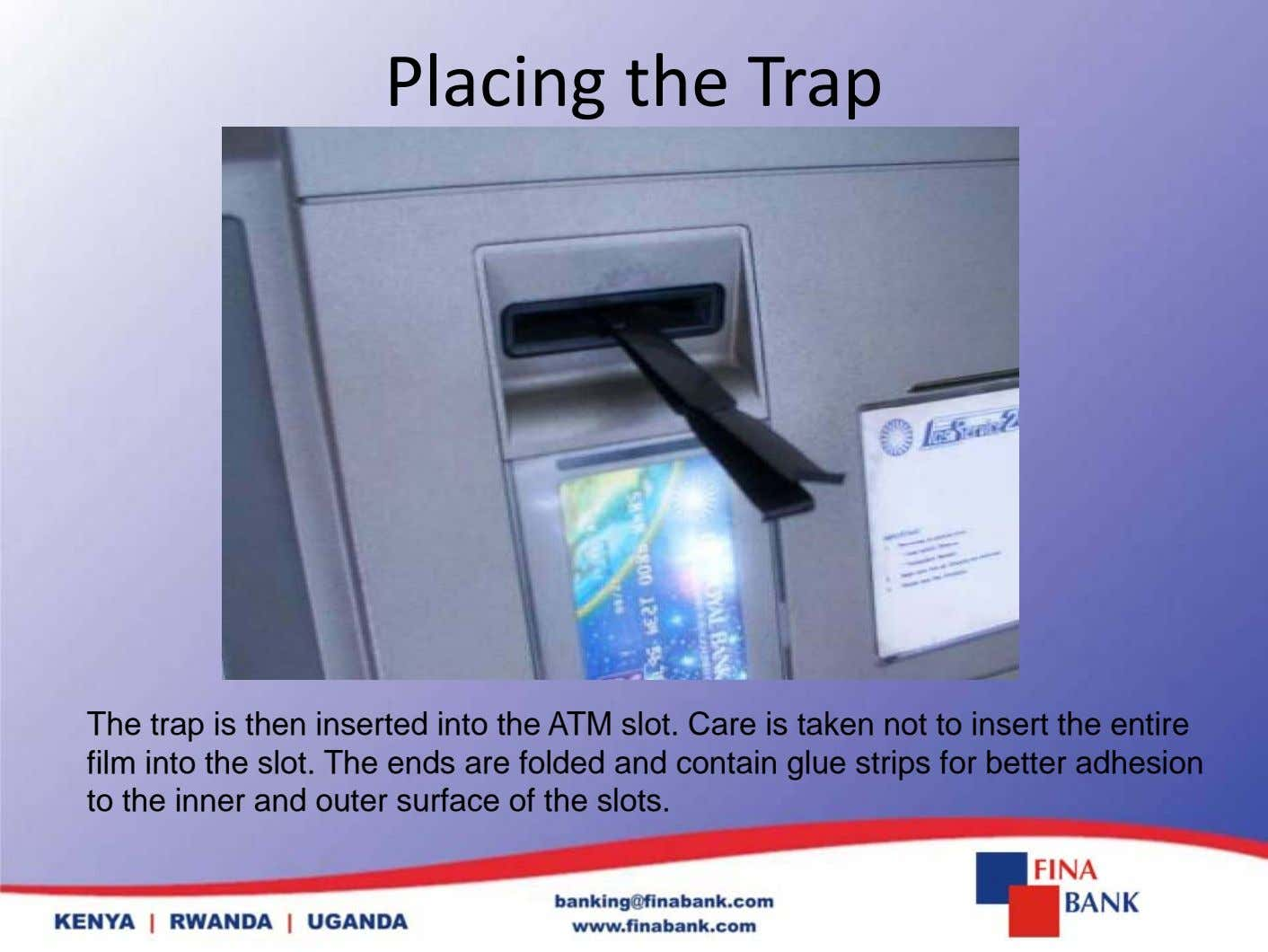 Placing the Trap The trap is then inserted into the ATM slot. Care is taken