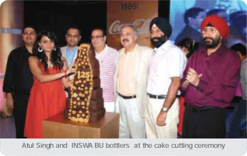 Atul Singh and INSWA BU bottlers at the cake cutting ceremony