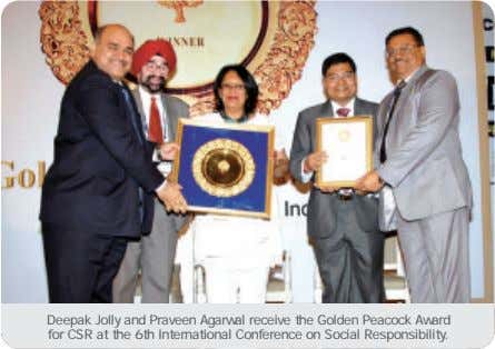 Deepak Jolly and Praveen Agarwal receive the Golden Peacock Award for CSR at the 6th