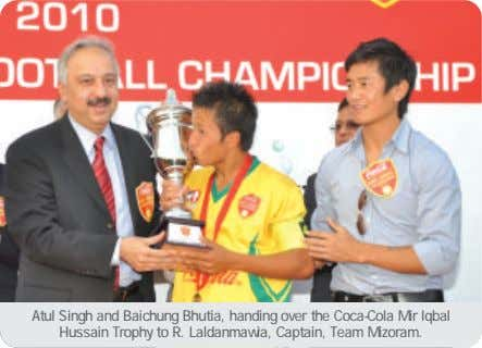 Atul Singh and Baichung Bhutia, handing over the Coca-Cola Mir Iqbal Hussain Trophy to R.