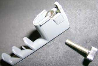 knurled screw, taking care that the nut remains in place   Pressing the nut with your