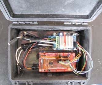 drivers and protection fuses inside a waterproof Pelicase. The mounting of the Arduino Mega (with shield),