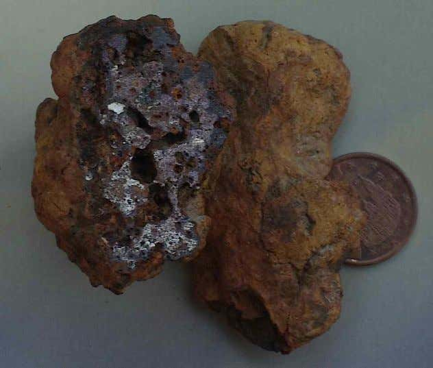 Fig. 2. Strongly magnetic iron-metallic chunks reminding of iron shale. Coin diameter 21 mm. Fig.