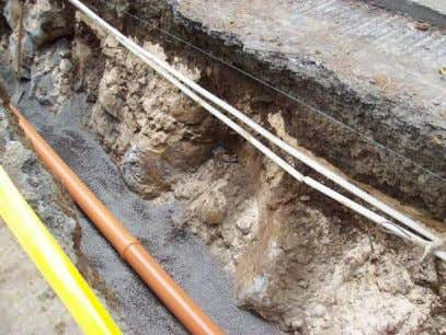 specification. The sewer pipe is placed on this layer of bedding. Its purpose is to protect