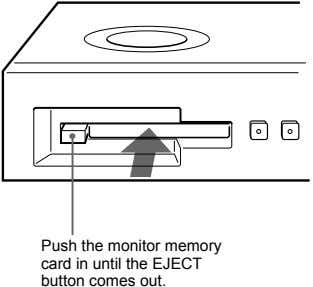 Push the monitor memory card in until the EJECT button comes out.