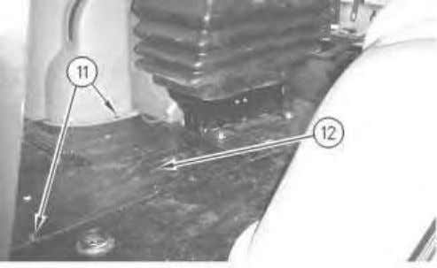 Remove two bolts (8) and plate (9) . Remove floor mat (10) . Illustration 5 g00869469