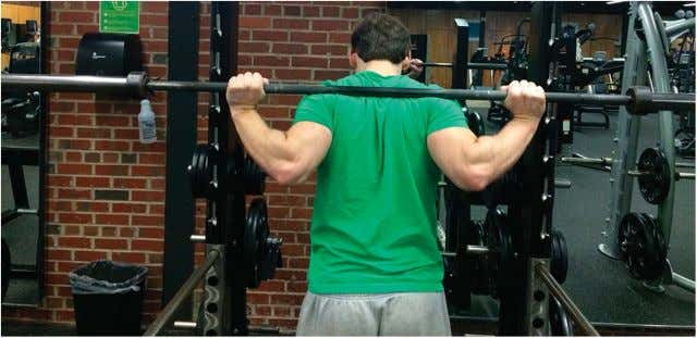 Figure 3. Low-bar barbell position. mass and may influence the type of squat technique that