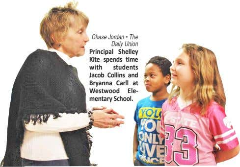 of the Chase Jordan • The Daily Union Principal Shelley Kite spends time with students