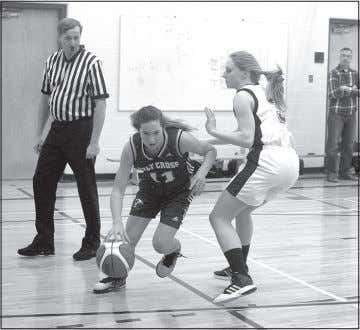 the tournament in second place. Justin Seward Photos The Holy Cross Collegiate Hawks senior girls basketball