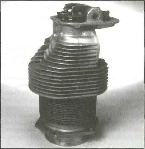 1 - 1 8 CYLINDERS Figure 1-30. The cylinder assembly along with the piston assembly, connecting