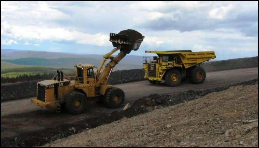 series of photos demonstrates a typical loading sequence. Truck approaches front-end loader from the left side.