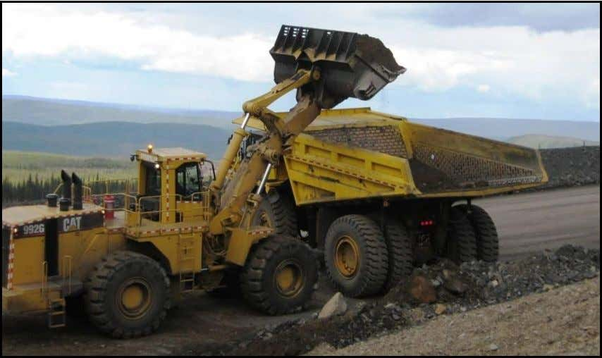 waits in truck cab while loader fills the truck bed. FAIRFIELD MINES Loader operator continues to