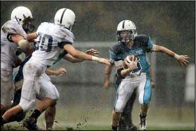 Absent at the time of the photo was Coach Brian Stashak. Dallas quarterback Ryan Zapoticky runs