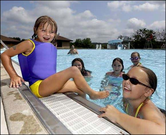 Sunday, September 16, 2012 THE DALLAS POST PAGE 3 Seven-year-old Emmalee Carlsson, left, of Kingston Township,