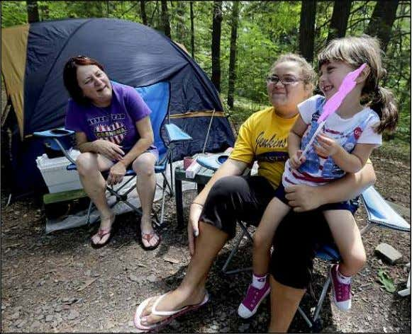 Kingston Township Recre- ation Program Summer Camp move in. Cousins Isabella Nero, right, of Wilkes-Barre, and
