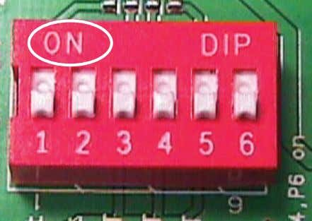tweezers to move the switch into the On or Off position. Figure 4 DIP Switch 1102