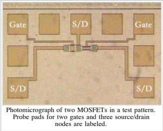 Photomicrograph of two MOSFETs in a test pattern. Probe pads for two gates and three