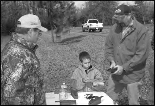 BARBOR COUNTY YOUTH HUNT – continued 6-yr. old Evan Cole tries his hand at turkey calling