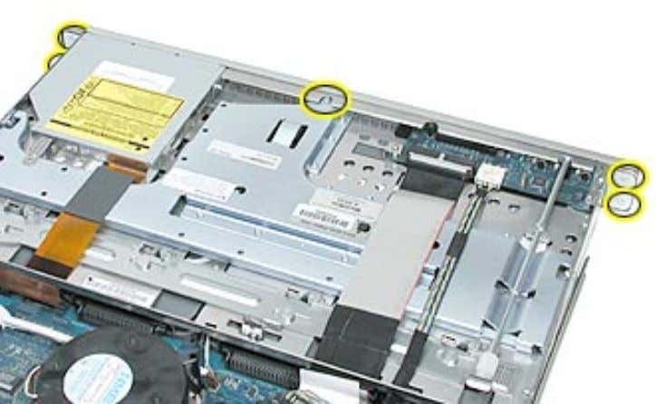 the screw that attaches the top of the bezel to the server. 3. Gently pull the