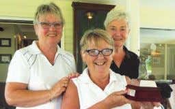 scores. Winner of the Granny Cup with 35 points was Maureen Flack (photographed receiving the trophy