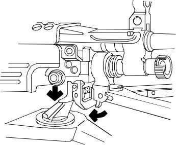 Engage the mounting pin of the gun into the pintle of the tripod by squeezing the