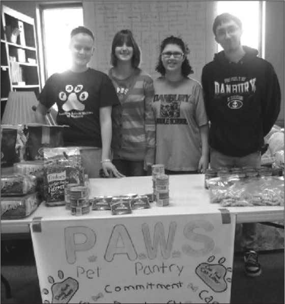 to sustaining its month- ly pet pantry in Danbury Township. Immaculate Conception School's first graders build
