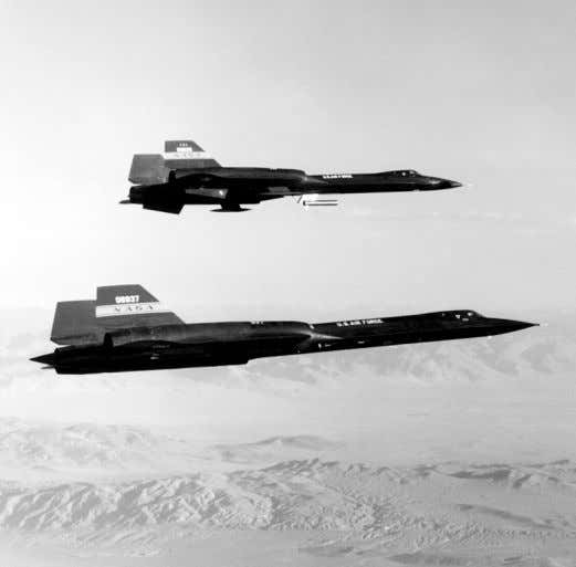 "the three existing YF-12A aircraft: 06934, 06935, and 06936. ""YF-12C"" (foreground) and YF-12A in flight. (NASA"