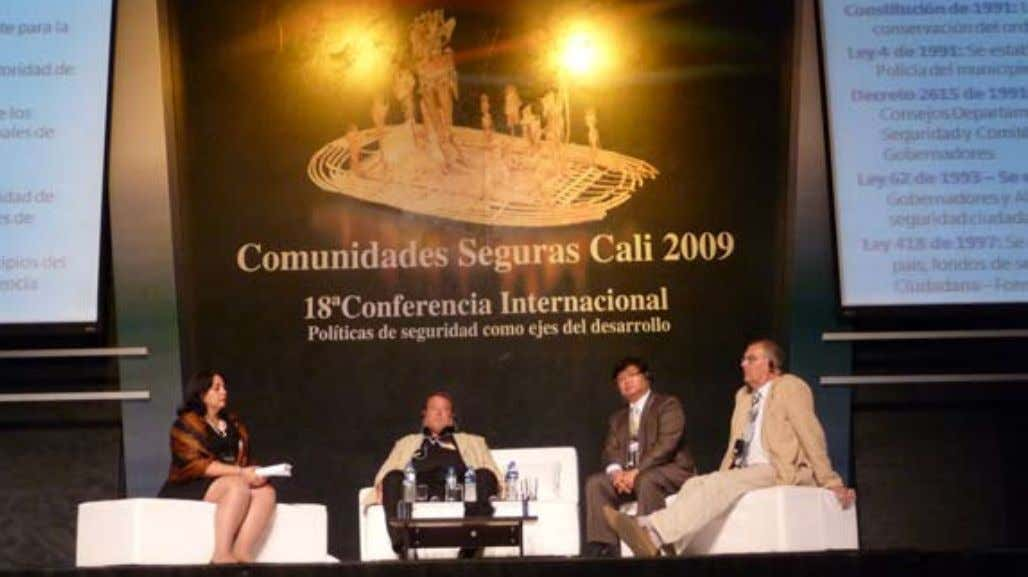 Photo 4.5. Four leaders in the International Safe Communities movement discussing the concept of safety