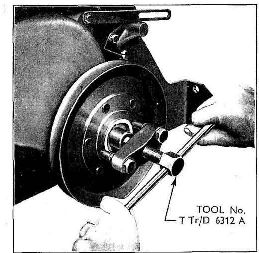 Fig. 31 Removing Crankshaft Pulley Carefully tap thc radius rod sideways across the front axle