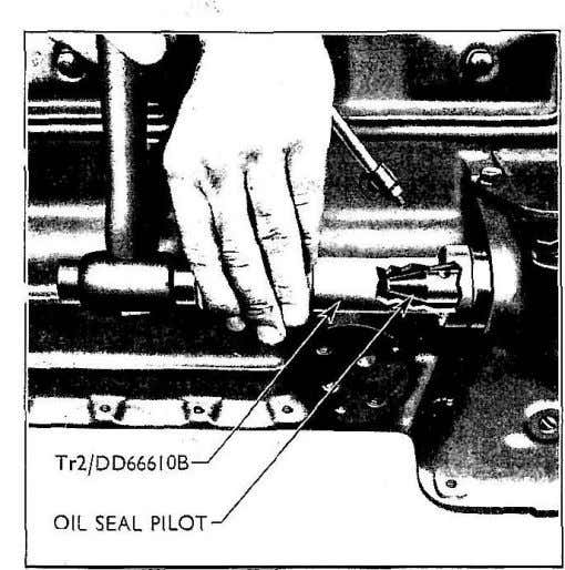 1 Drain the cooling system and remove a battery lead. Fig. 37 Replacing Auxiliary Drive Shaft