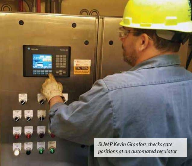 SUMP Kevin Granfors checks gate positions at an automated regulator.